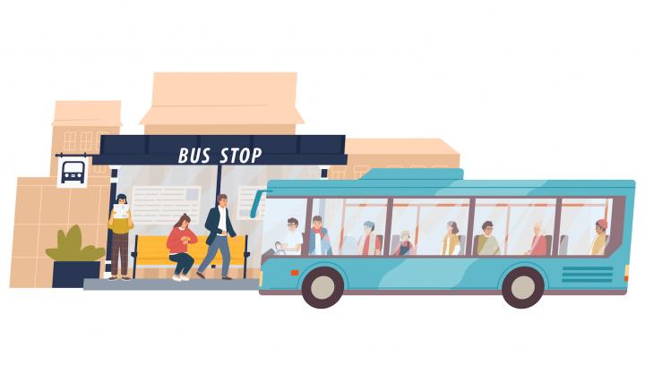 Stație de autobuz cu autobuzul în prim plan
