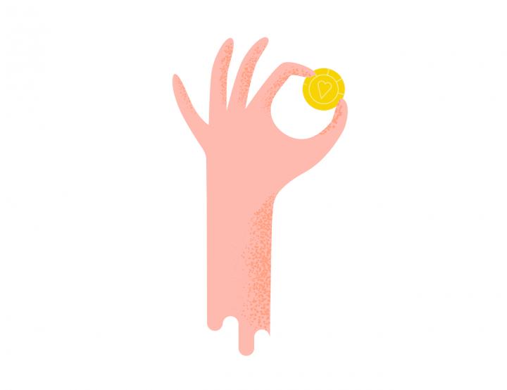 Mână care ține bani